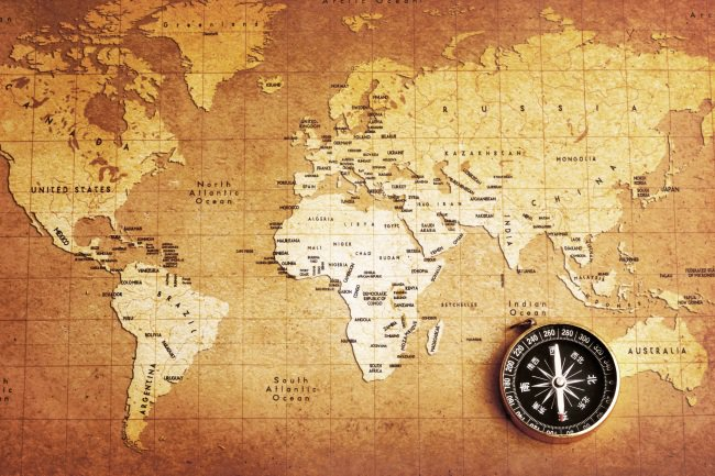 shutterstock_56191717_compass and map_our story